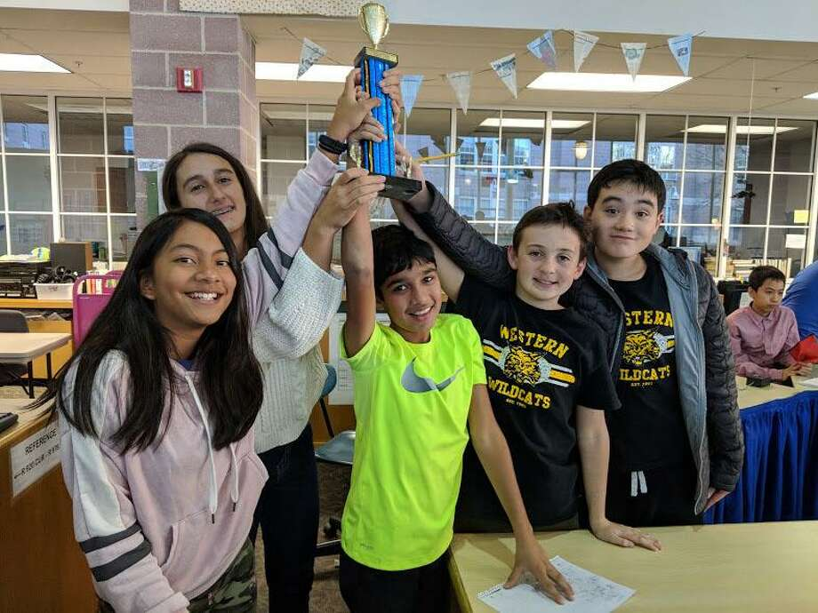 Western Middle School's Quiz Bowl team won the regional competition held at Middlesex School in Darien. The A team will advance to nationals this May. Photo: Contributed /