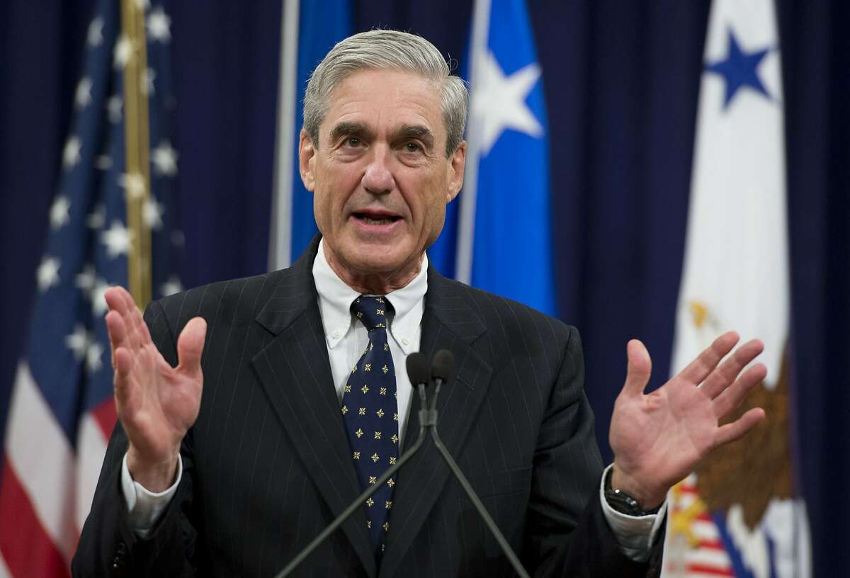 """(FILES) In this file photo taken on August 1, 2013, former Federal Bureau of Investigation (FBI) Director Robert Mueller speaks during a farewell ceremony in Mueller's honor at the Department of Justice. - Donald Trump ripped into the Russia collusion probe November 7, 2018, calling it a """"disgusting Witch Hunt"""" as the end of a two-month election hiatus freed Special Counsel Robert Mueller to resume issuing indictments and pressing for the president himself to answer questions. The end of a Justice Department quiet period for the probe was expected to open the door for Trump's nemesis to resume filing charges and issuing subpoenas, with the president widely believed under investigation for possible obstruction of justice. (Photo by Saul LOEB / AFP)SAUL LOEB/AFP/Getty Images"""