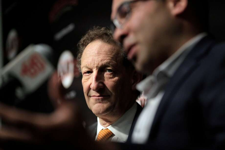 Giants CEO Larry Baer listens to Farhan Zaidi answer a question after he introduced Zaidi as the new president of baseball operations during a press conference at AT&T Park, in San Francisco, Calif., on Wednesday, November 7, 2018. Photo: Carlos Avila Gonzalez / The Chronicle