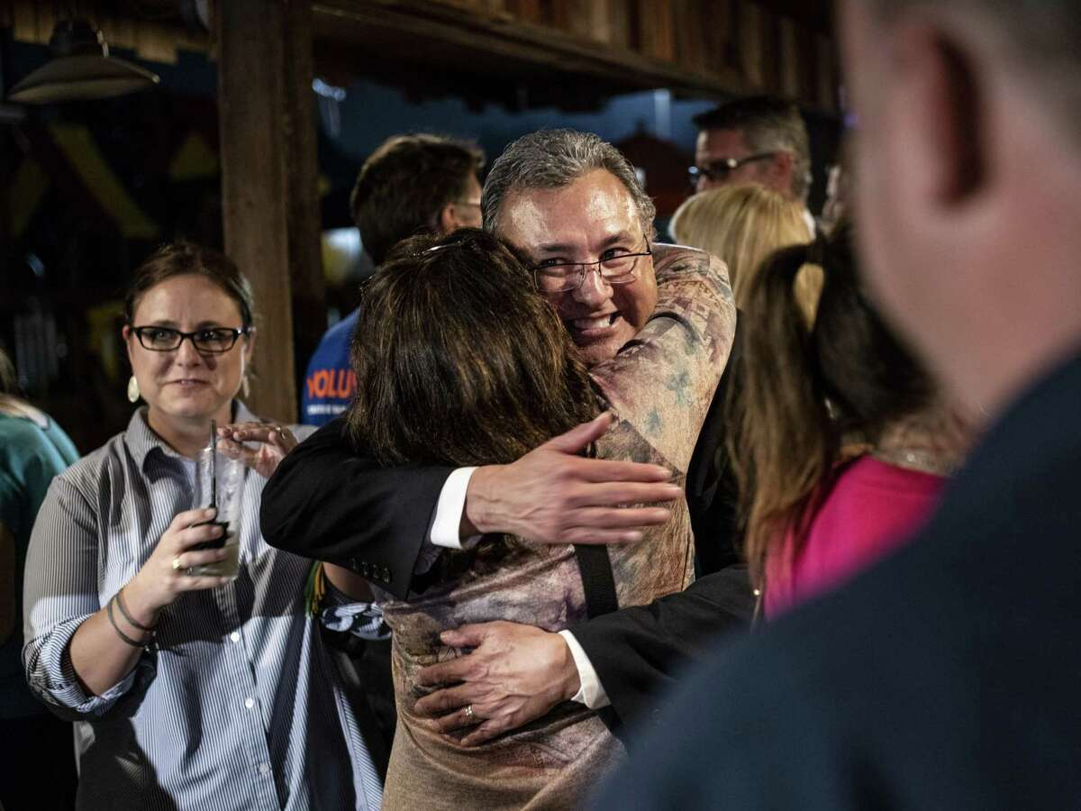 Joe Gonzales hugs a supporter during his watch party at Backyard on Broadway before being elected as District Attorney for Bexar County, on Tuesday, November 6, 2018.