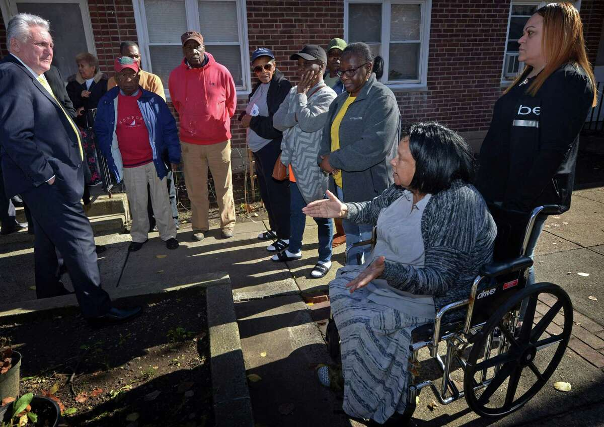Residents including HelenThorne express their frustration with Norwalk Mayor Harry Rilling and other officials as they visit to Washington Village to check on living conditions of the remaining residents there Wednesday, November 7, 2018, in Norwalk, Conn. The Washington Village revitalization project in South Norwalk is tearing down Connecticut's oldest public housing complex and replacing it with a three phase development, Soundview Landing.