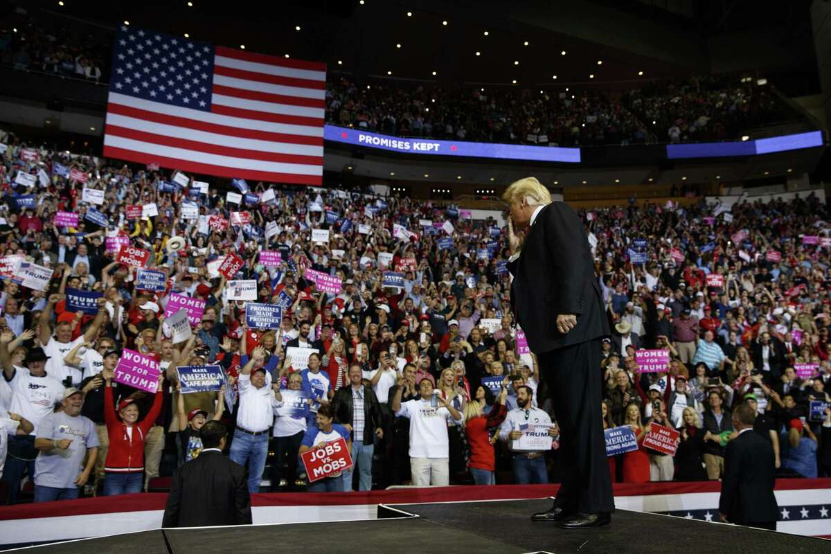 President Donald Trump blows a kiss as he arrives for an Oct. 22 campaign rally for Sen. Ted Cruz, R-Texas, at the Toyota Center in Houston.