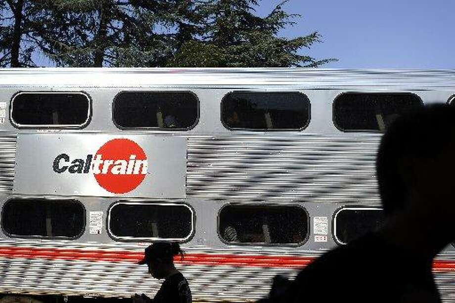 People wait on the platform as a Caltrain pulls into the University Ave. stop in Palo Alto, CA Friday, August 7, 2015. Photo: Special To The Chronicle