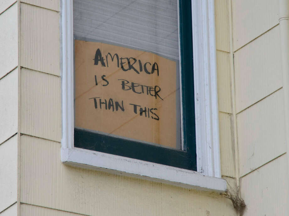 The resistance isn't just in the streets — it's in the windows. In several San Francisco neighborhoods, particularly the Mission District and Potrero Hill, residents have been placing political signs in their windows in response to policies from President Donald Trump and his administration. Photo: Junaid Ackroyd/ Alta Online