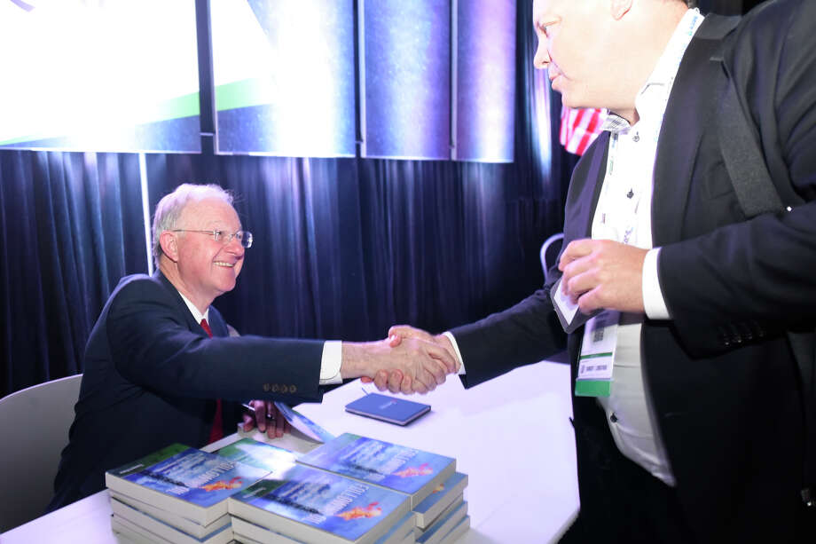 Tom Petrie signs a copy of his book for Shane McElroy of Siemens during the Executive Oil Conference Nov. 7, 2018, at Horseshoe Pavilion.  James Durbin/Reporter-Telegram Photo: James Durbin / ? 2018 Midland Reporter-Telegram. All Rights Reserved.