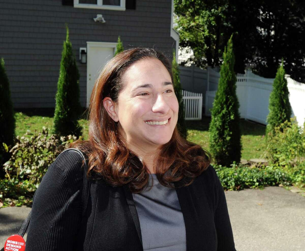 Laura Kostin, the Democratic candidate running for State Representative for District 151, canvasses on Halsey Drive in Old Greenwich, Conn., Wednesday, Oct. 17, 2018.