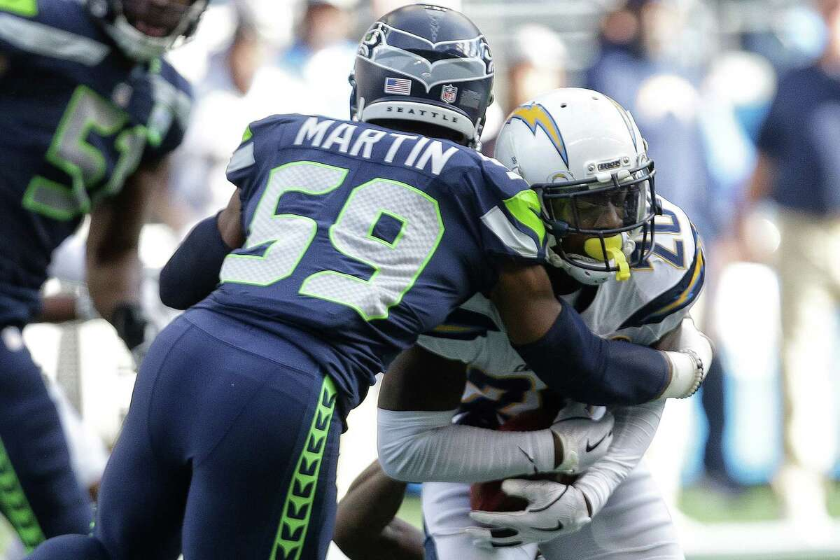 Seahawks defensive lineman Jacob Martin (59) tackles Chargers corner back Desmond King II during Seattle's game against the LA Chargers, Sunday, Nov. 4, 2018 at CenturyLink Field.