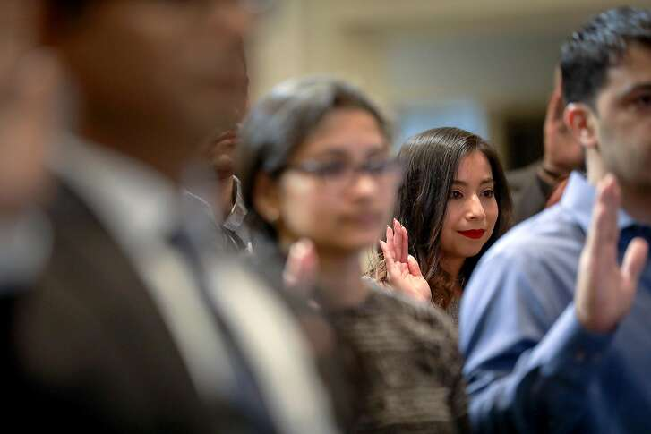 Miriana Arellano smiles as she finishes the Oath of Allegiance during a naturalization ceremony at Houston City Hall, Wednesday, Nov. 7, 2018, in Houston. Arellano was brought from Mexico as an undocumented immigrant when she was less than two years old.
