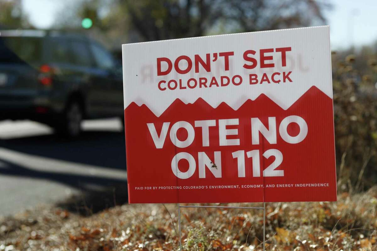 A sign stands along St. Paul Street in south Denver that calls for voters to cast their ballots against Proposition 112, which would tightly restrict where new oil and gas wells can be drilled across the state. More than 56 percent of Colorado voters voted the proposition down.