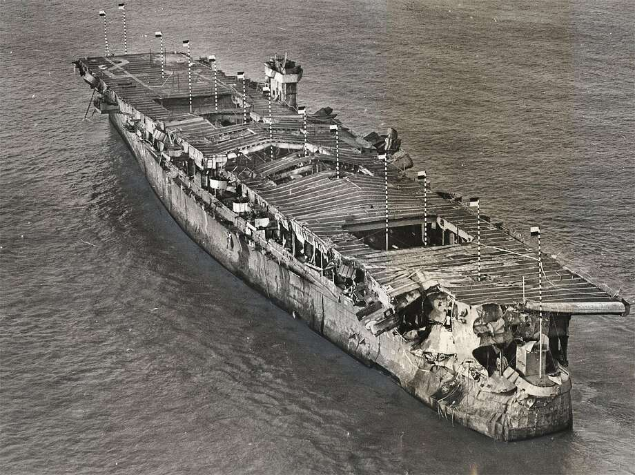 An aerial view of the aircraft carrier Independence at anchor in San Francisco Bay in 1951. Damage from the atomic bomb tests at Bikini Atoll is visible. The ship, eventually scuttled in the waters off the Farallon Islands, was recently located by federal scientists. Photo: Courtesy S.F. Maritime National Park 1951
