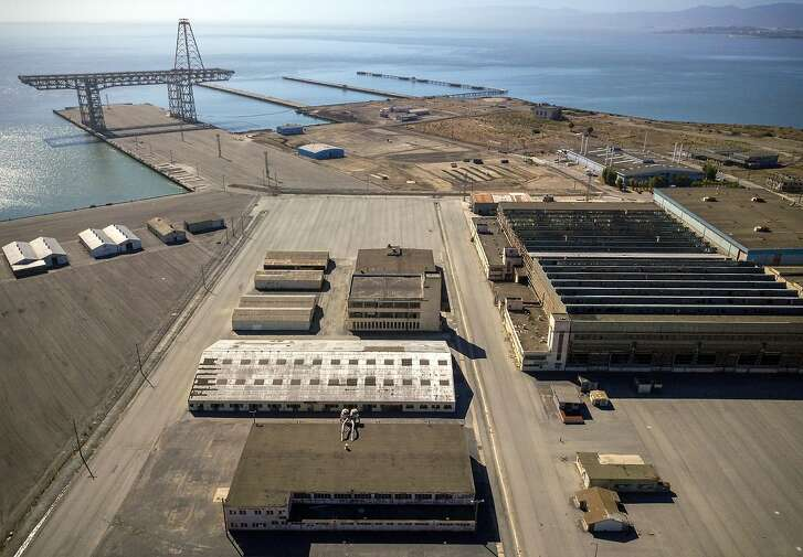 "Aerial photos of Hunters Point Naval Shipyard showing Buildings 366 (white on left, middle) 351, above that on the right, and 411 (middle on the right) in Parcel G in San Francisco, Calif., on Tuesday, September 11, 2018. The Navy's retesting plan for Parcel G is being brought into question. When the U.S. Navy pledged to perform new soil tests at its Superfund waste site in San Francisco, the priority was ""to protect the human health and the environment."" But the Navy's re-testing plan is largely based on a cost-cutting report it paid a defense contractor to put together more than six years ago. What's more, the old report relies on data collected by Tetra Tech, the cleanup firm that submitted fake measurements and got caught. It essentially advocates for lowering cleanup standards and leaving more radioactivity in the ground.  Multiple government agencies have now come out against the Navy?s plan to re-test Parcel G, saying that it could put public health at risk if it is not changed. Environmental experts agree and say even if the Navy listens to those agencies the plan is flawed and falls far short of what was promised in the wake of the Tetra Tech fraud revelations."