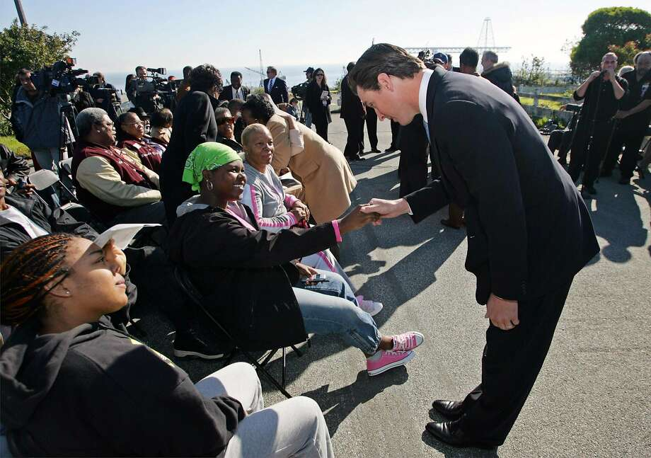Former S.F. Mayor and current California governor-elect Gavin Newsom (right) greets community members before a 2005 ceremony in which the Navy transferred 75 acres of the former Hunters Point Naval Shipyard to San Francisco. Photo: Eric Risberg / Associated Press 2005