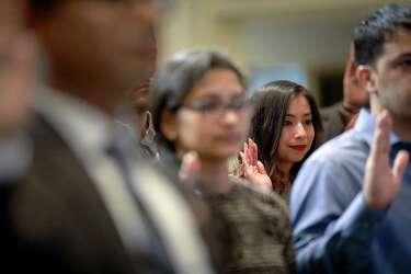 Fifty take citizenship oath at Houston City Hall - Houston