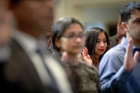 Fifty take citizenship oath at Houston City Hall - Houston