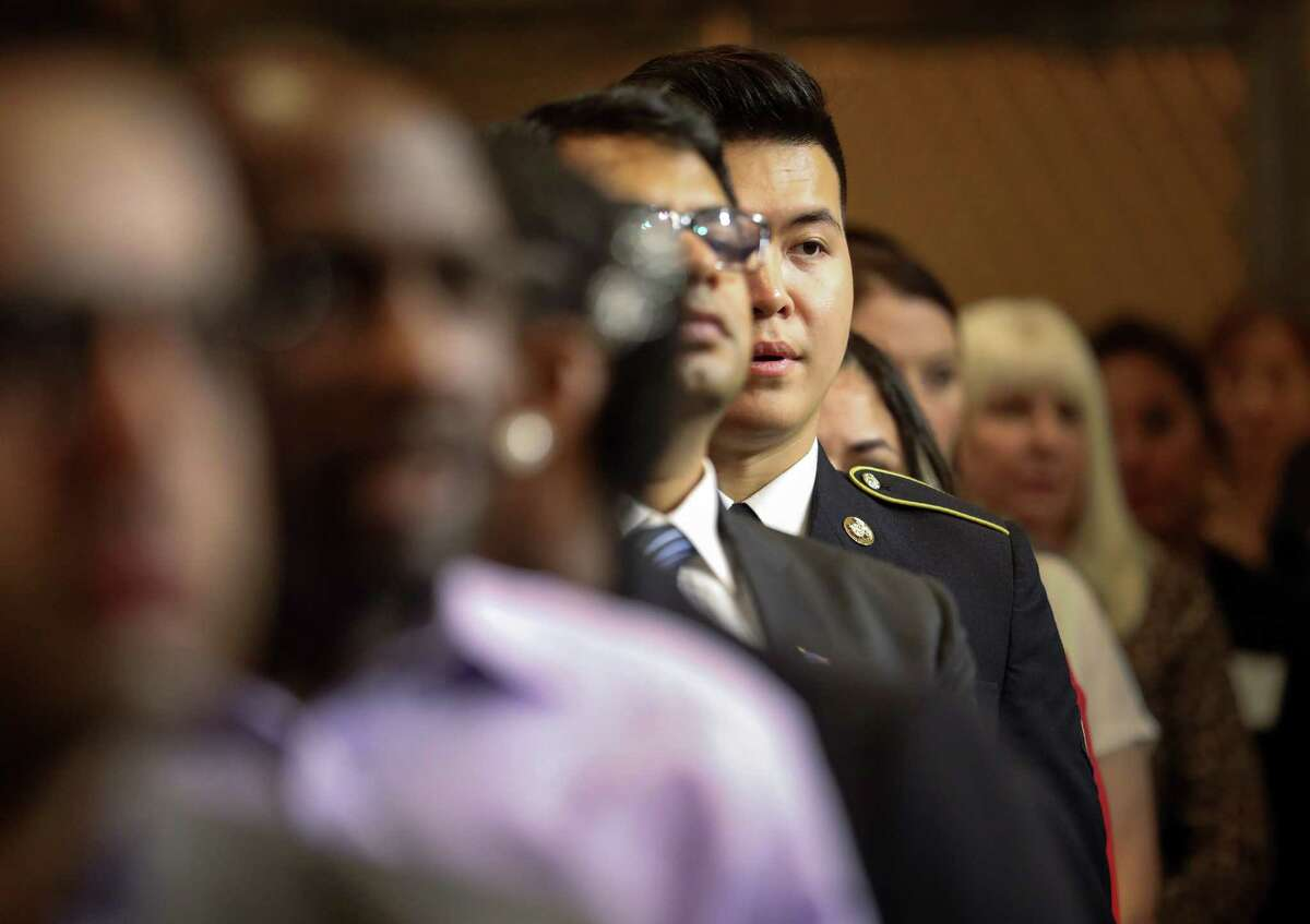 Duong Tran, who was born in Vietnam and is serving in the U.S. Army, sings the National Anthem during a naturalization ceremony at Houston City Hall, Wednesday, Nov. 7, 2018, in Houston. Tran said he did not know a single word of English when he came to the United States in 2012.