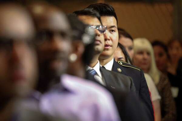 Fifty take citizenship oath at Houston City Hall