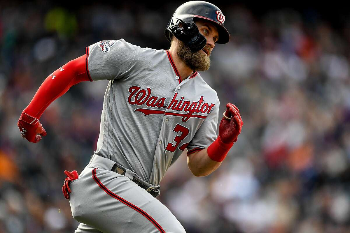 DENVER, CO - SEPTEMBER 30: Bryce Harper #34 of the Washington Nationals runs out a ninth inning double against the Colorado Rockies at Coors Field on September 30, 2018 in Denver, Colorado. ~~