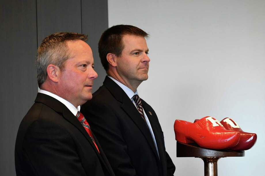 Rensselaer Polytechnic Institute football coach Ralph Isernia, left, and Union College coach Jeff Behrman, right, stand next to the Dutchman Shoes trophy during a press conference at Rensselaer Polytechnic Institute on Wednesday, Nov. 7, 2018, in Troy, N.Y. Union and RPI football teams will play for the coveted trophy on Saturday in Troy. (Will Waldron/Times Union) Photo: Will Waldron / 40045372A