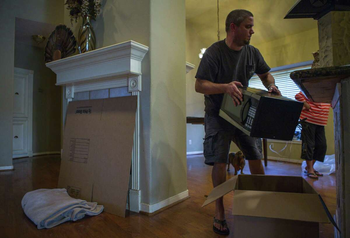 Matt Sprague packs up the last of his belongings from his family's home in west Houston after closing on the sale of the home, Thursday, Aug. 30, 2018 in Houston. Sprague had an offer on the house virtually overnight using the web-based service Opendoor.