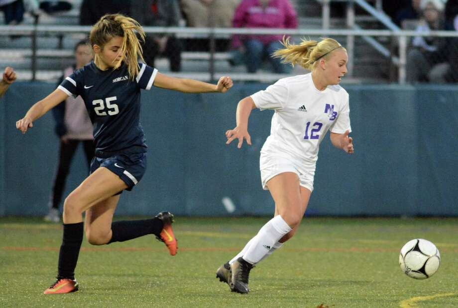 North Branford's Ashley Amendola gets away from Morgan's Madison Emmi during a Class M girls soccer playoff game on Wednesday, Nov. 7, 2018. Morgan won 2-1. Photo: Dave Phillips / For Hearst Connecticut Media / Contributed Photo / Greenwich Time Contributed
