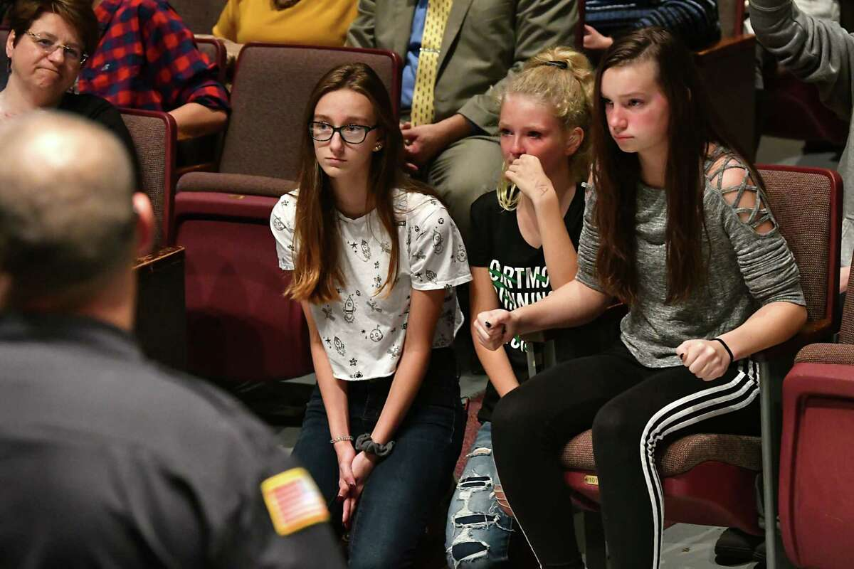 From left, sophomore Nadia Budrakey, 15, freshman Ava Giagni, 14, and sophomore Emily Chotkowski, 15, wait to ask questions as teachers and school officials hold a public forum to discuss Monday's lockdown at Niskayuna High School on Wednesday, Nov. 7, 2018 in Niskayuna, N.Y. The students were denied the opportunity to ask questions at this forum and it was explained they could ask questions at the student forum. (Lori Van Buren/Times Union)