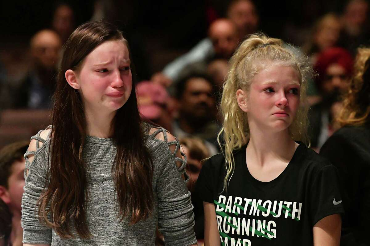 Sophomore Emily Chotkowski, 15, left, and freshman Ava Giagni, 14, show emotion after being silenced as teachers and school officials hold a public forum to discuss Monday's lockdown at Niskayuna High School on Wednesday, Nov. 7, 2018 in Niskayuna, N.Y. The students were denied the opportunity to ask questions at this forum and it was explained they could ask questions at the student forum. (Lori Van Buren/Times Union)