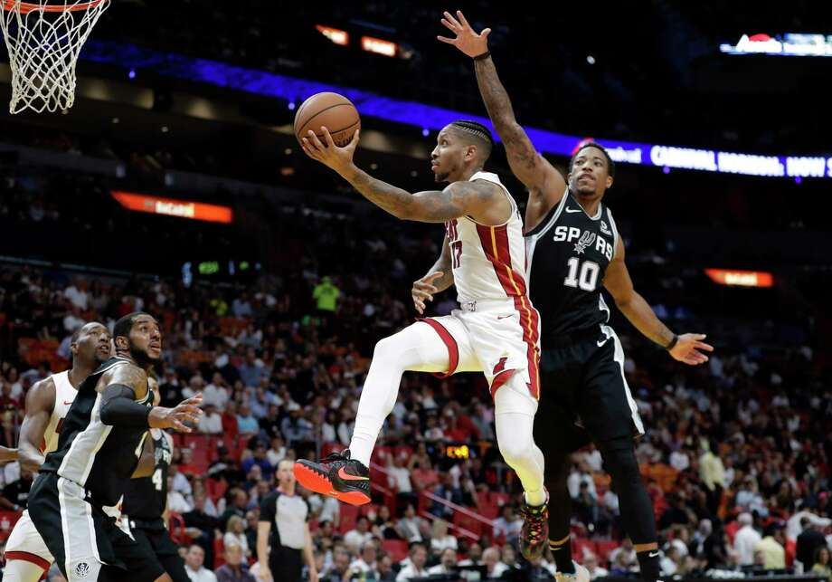Miami Heat forward Rodney McGruder (17) drives as San Antonio Spurs guard DeMar DeRozan (10) defends during the first half of an NBA basketball game, Wednesday, Nov. 7, 2018, in Miami. (AP Photo/Lynne Sladky) Photo: Lynne Sladky, Associated Press / Copyright 2018 The Associated Press. All rights reserved.
