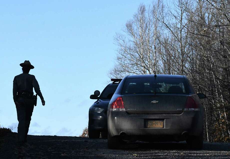 New York State Police trooper blocks traffic on Rossman Valley Road where police are investigating the scene of two suspicious death on Wednesday, Nov. 7, 2018, in Summit, N.Y. A preliminary investigation has revealed the individuals died overnight on Monday. (Will Waldron/Times Union) Photo: Will Waldron / 20045422A