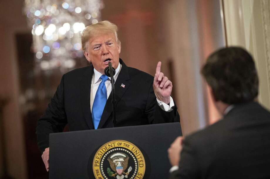 President Trump argues with CNN reporter Jim Acosta during a news conference in the White House on Wednesday. Photo: Bloomberg Photo By Al Drago / Bloomberg