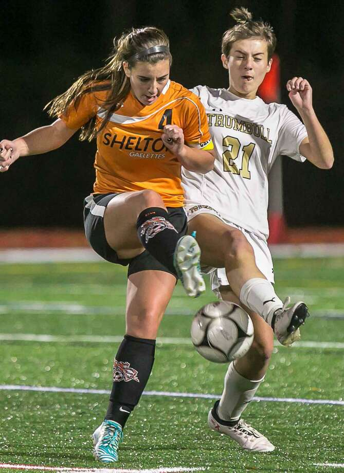 Trumbull's Caitlin Rodko and Shelton's Mackenzie Joyce battle for possession during Trumbull's Class LL win Wednesday evening in Shelton. Photo: John Vanacore / For Hearst Connecticut Media / (c)John H.Vanacore/For Hearst Connecticut Media