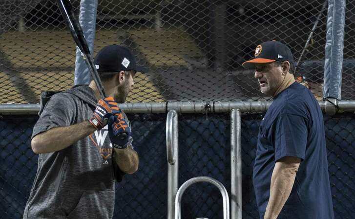 On the eve of the 2017 World Series, former Astros hitting coach Dave Hudgens, right, works at Dodger Stadium with pitcher Justin Verlander, who as the Game 2 starter would have to hit in the National League ballpark.