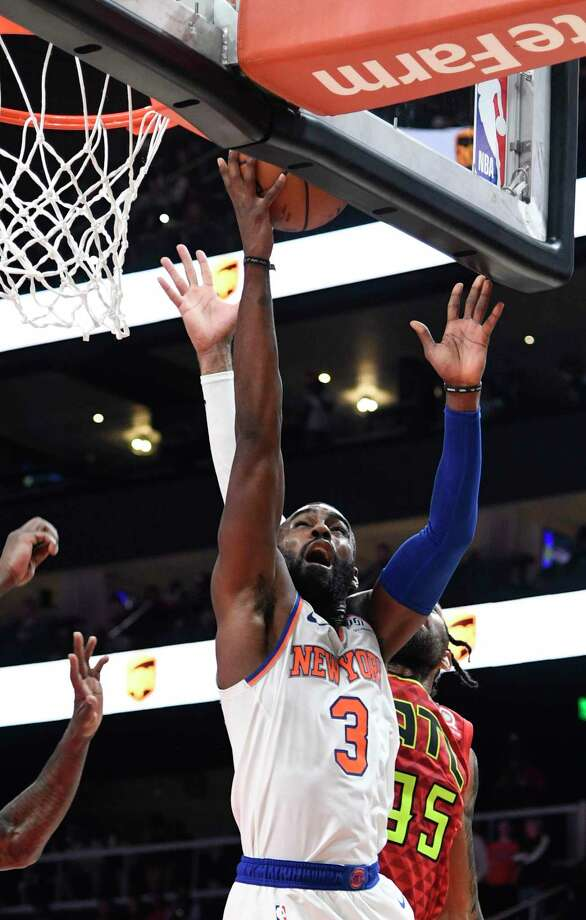 New York Knicks guard Tim Hardaway Jr. (3) shoots as Atlanta Hawks forward DeAndre' Bembry defends during the second half of an NBA basketball game Wednesday, Nov. 7, 2018, in Atlanta. New York won 112-107. (AP Photo/John Amis) Photo: John Amis / Copyright 2018 The Associated Press. All rights reserved