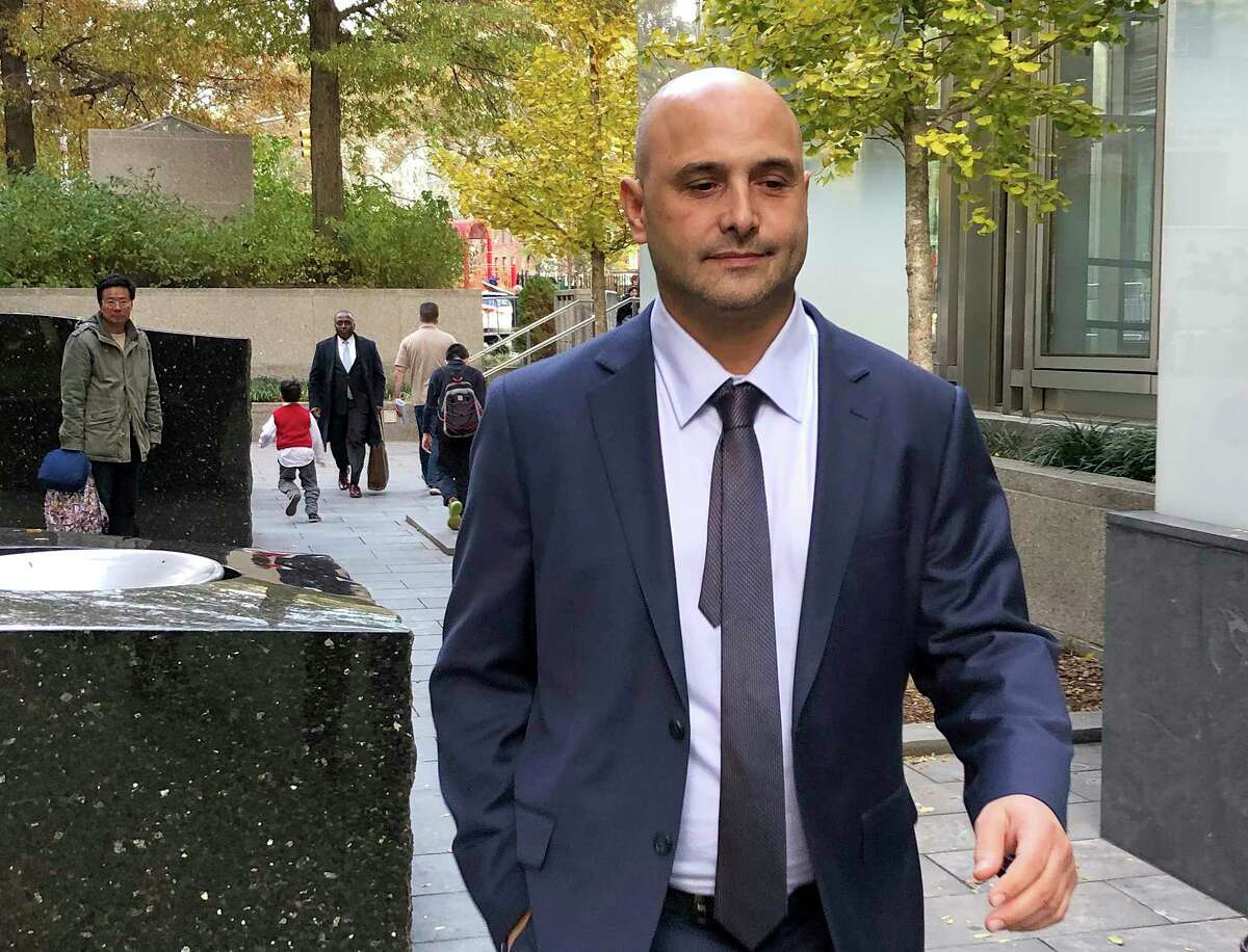 Former sports radio host Craig Carton leaves Manhattan federal court Wednesday, Nov. 8, 2018, in New York after being convicted of fraud for diverting money from investors in a ticket reselling business for his own needs, including gambling expenses.