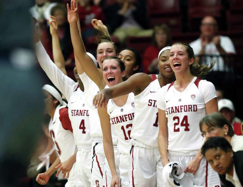 Stanford's Lacie Hull (24), Maya Dodson and Lexie Hull (12) cheer a Cardinal basket at end of 2nd quarter against UC Davis during Women's NCAA basketball game at Maples Pavilion in Stanford, Calif.. on Wednesday, November 7, 2018. Photo: Scott Strazzante / The Chronicle / San Francisco Chronicle