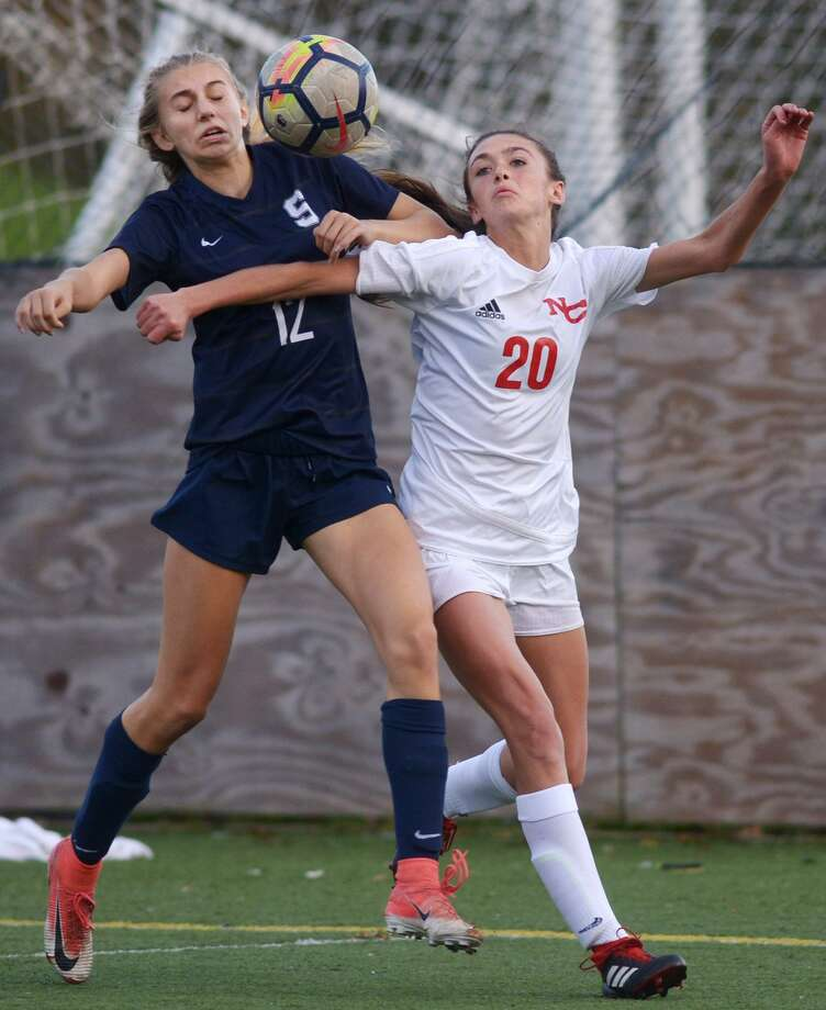 Wrecker #12 Cailyn Lesher and Ram #20 Emma Schuh battle for the ball as the Staples High School Wreckers take on the New Canaan High School Rams in their Class LL girls soccer game Wednesday, November 7, 2018, at Wakeman Fields in Westport, Conn. Photo: Erik Trautmann / Hearst Connecticut Media / Norwalk Hour