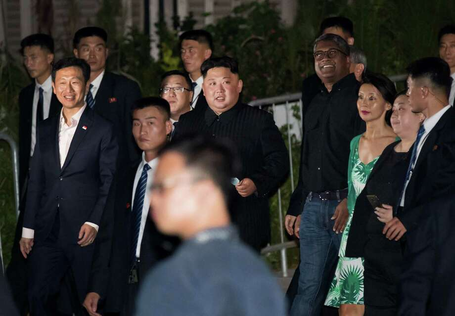 North Korean leader Kim Jong Un (center) tours the Esplanade in Singapore on June 11, 2018. Photo: Bloomberg Photo By SeongJoon Cho. / © 2018 Bloomberg Finance LP
