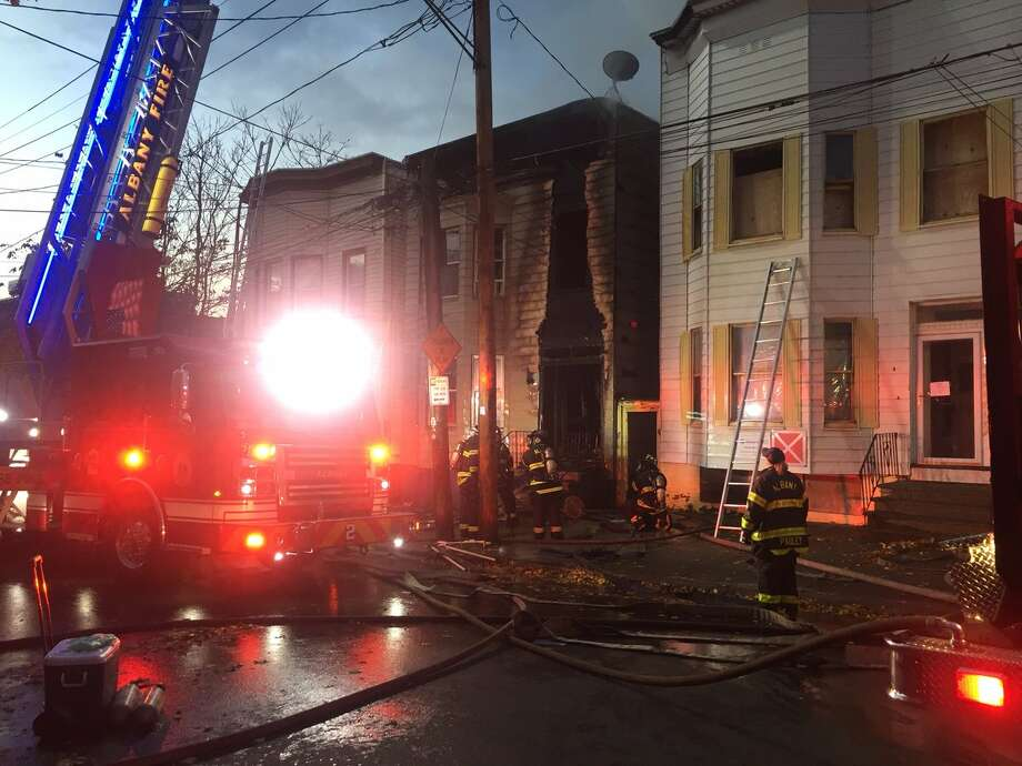 Smoke was still pouring from the eaves of a Albany home that caught fire earlier Thursday morning. It was unclear what caused the blaze at 294 Sheridan Ave. Photo: Steve Hughes / Times Union