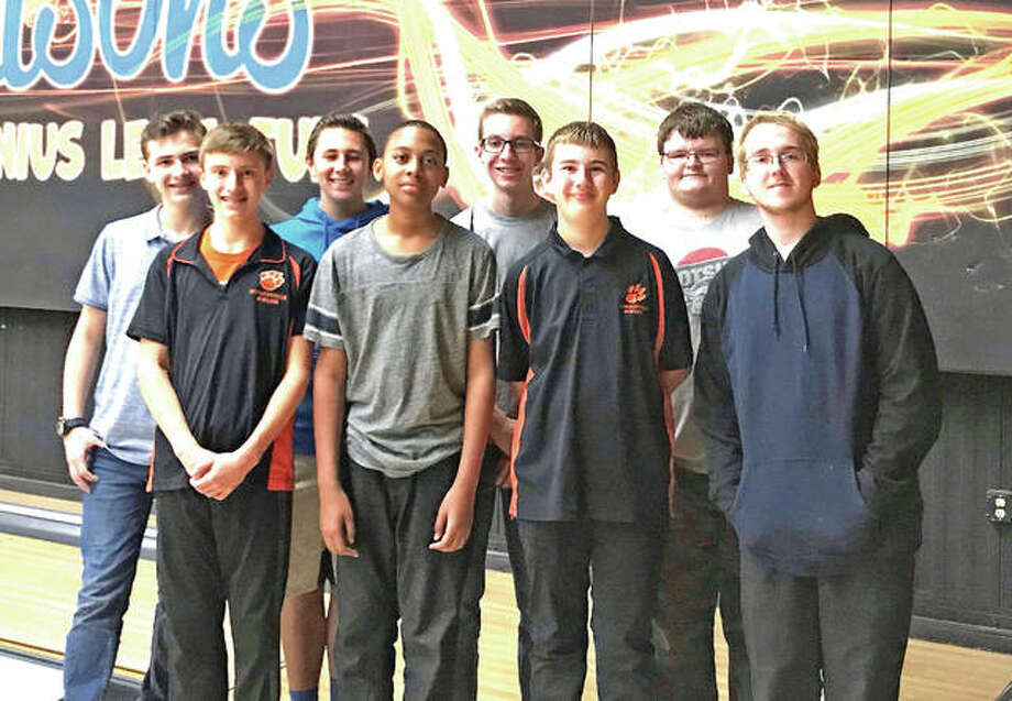 The Edwardsville boys' bowling team poses for a photo after a recent practice at Edison's Entertainment Center. EHS returns to action at 3 p.m. Thursday in the second day of the Southwestern Conference Tournament at Bel-Air Bowl in Belleville. Photo: For The Intelligencer