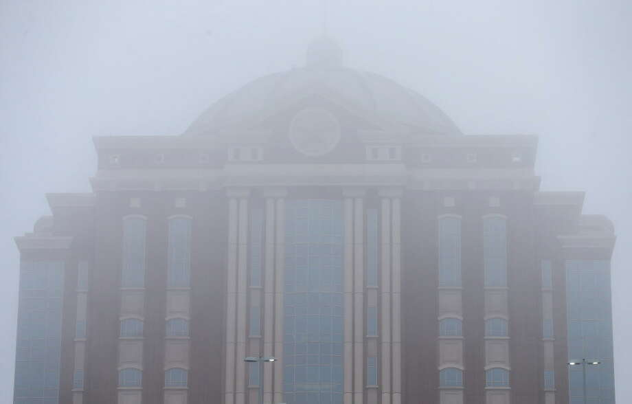The Harris County Civil Courthouse covered by the fog Thursday, Nov. 8, 2018, in Houston. Photo: Godofredo A. Vasquez, Staff Photographer / 2018 Houston Chronicle