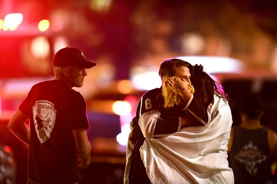 Witnesses console each other near the Borderline Bar & Grill after a shooter wounded seven Wednesday night on November 8, 2018 in Thousand Oaks, California. The gunman burst into the bar around 11:20 p.m., cloaked in all black as he threw smoke bombs and began shooting at targets as young as 18 inside the Borderline Bar & Grill, authorities and witnesses said. Photo: Wally Skalij/Getty Images