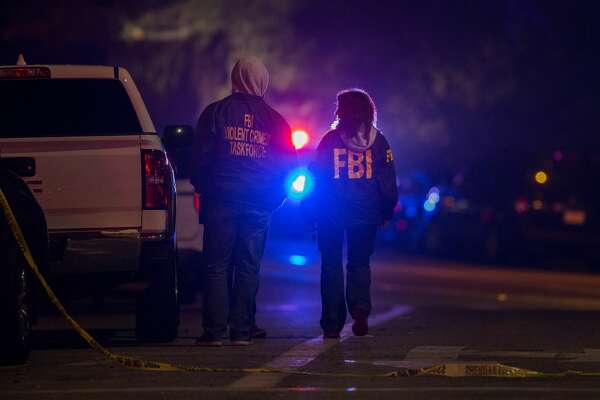 F.B.I. agents monitor the scene near the Borderline Bar and Grill, where a mass shooting occurred, on November 8, 2018 in Thousand Oaks, California. According to reports, at least 12 people have died, including a Ventura County Sheriffs Department sergeant, plus the gunman.