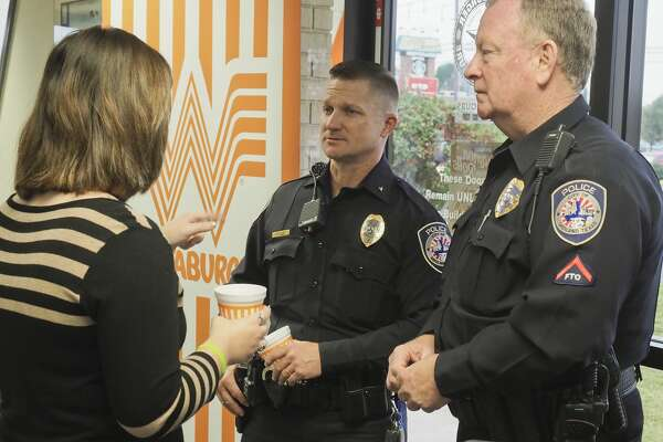 Camden Mize talks with Seth Herman, acting chief of police and Officer John Kerrigan 11/08/18 morning at Whataburber on Midkiff near Wadley, during Coffee with a Cop. Tim Fischer/Reporter-Telegram