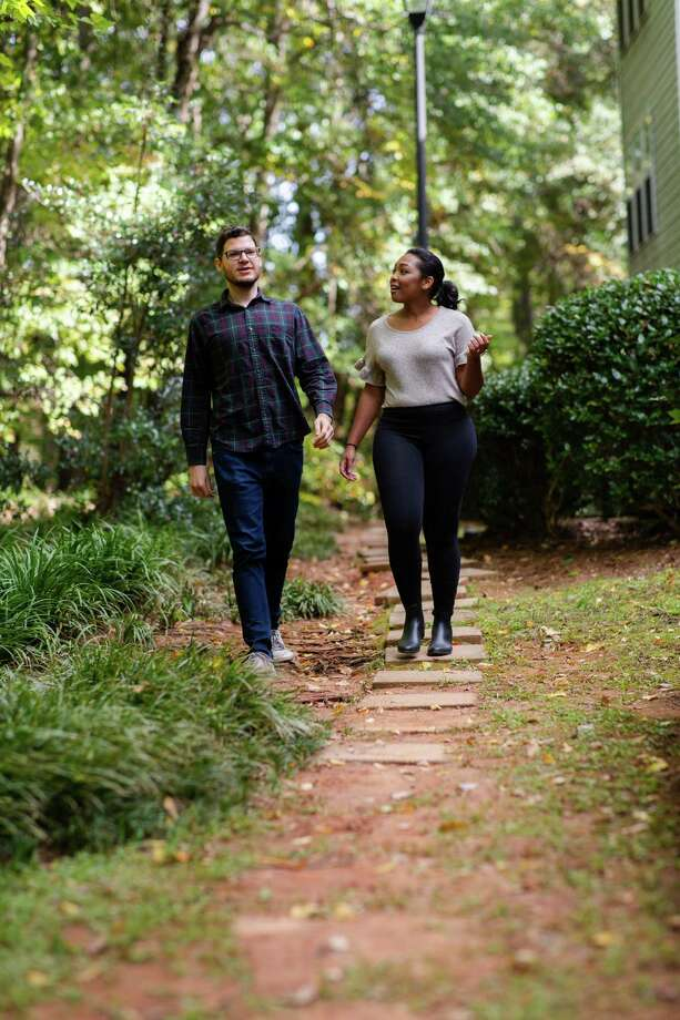 Ashley Brown and her fiance, Aaron Shuman, walk outside their condo in Atlanta. Photo: Photo For The Washington Post By Kevin D. Liles / For The Washington Post