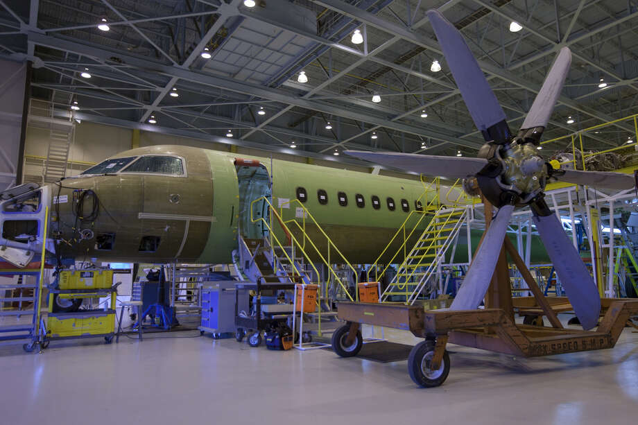 A Bombardier Q400 NextGen turboprop airliner under construction in one of the hangars at the Bombardier Aerospace plant at Downsview airport, in Toronto, on April 6, 2010. Photo: Bloomberg Photo By Norman Betts. / The Washington Post