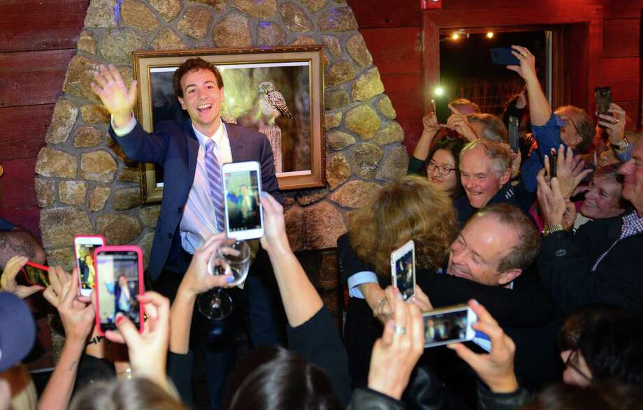 Democrat Will Haskell waves to supporters after defeating incumbent Republican Toni Boucher for state senate during a post election party at the Little Barn in Westport, Conn., on Tuesday Nov. 6, 2018. Photo: Christian Abraham / Hearst Connecticut Media / Connecticut Post