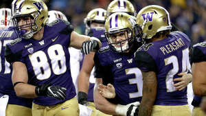 SEATTLE, WA - NOVEMBER 03: Jake Browning #3 of the Washington Huskies celebrates with Kamari Pleasant #24 of the Washington Huskies after rushing for a two yard touchdown against the Stanford Cardinal in the first quarter during their game at Husky Stadium on November 3, 2018 in Seattle, Washington.  (Photo by Abbie Parr/Getty Images)