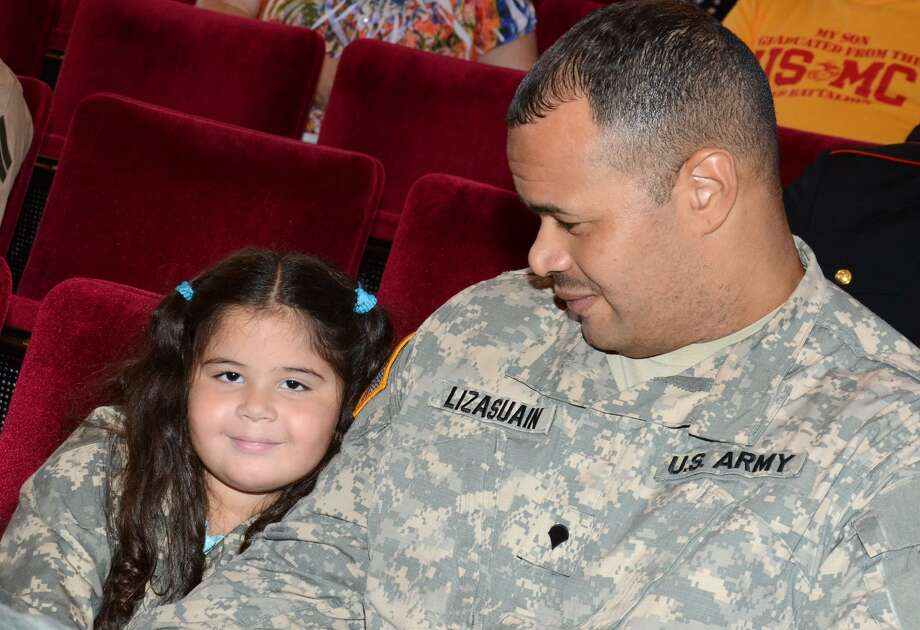 U.S. Army Specialist, Cielo Alfredo Lizasliain, of Hamden, shares a moment with his daughter, Olyvia Rose, 5, during the Veterans Day Ceremony at Norwalk City Hall on Friday, Nov. 11, 2011. Photo: Amy Mortensen / Amy Mortensen / Connecticut Post Freelance