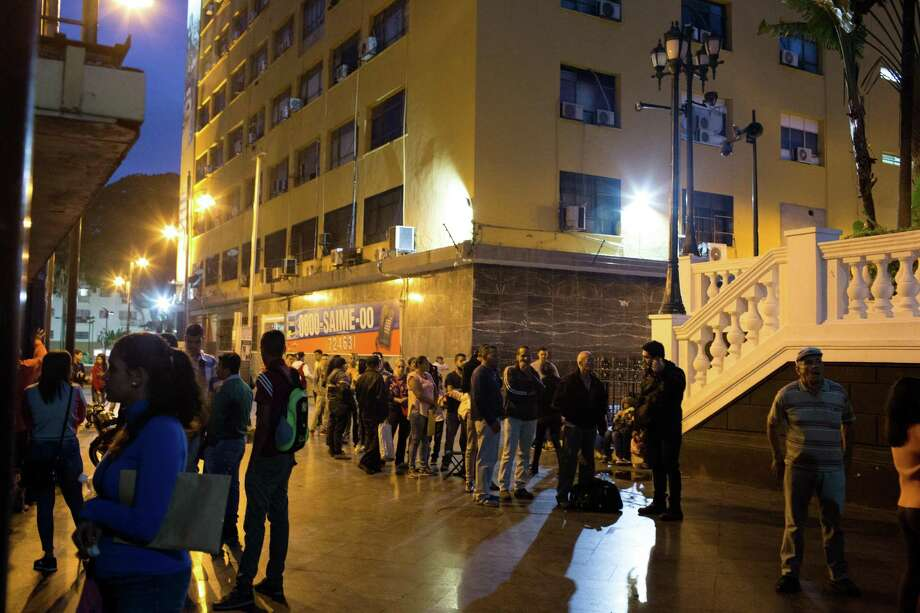 People wait in line overnight to apply for a passport at the Administrative Service of Identification, Migration, and Foreigners (SAIME) in Caracas, Venezuela, on Sept. 18, 2018. Photo: Bloomberg Photo By Manaure Quintero / © 2018 Bloomberg Finance LP