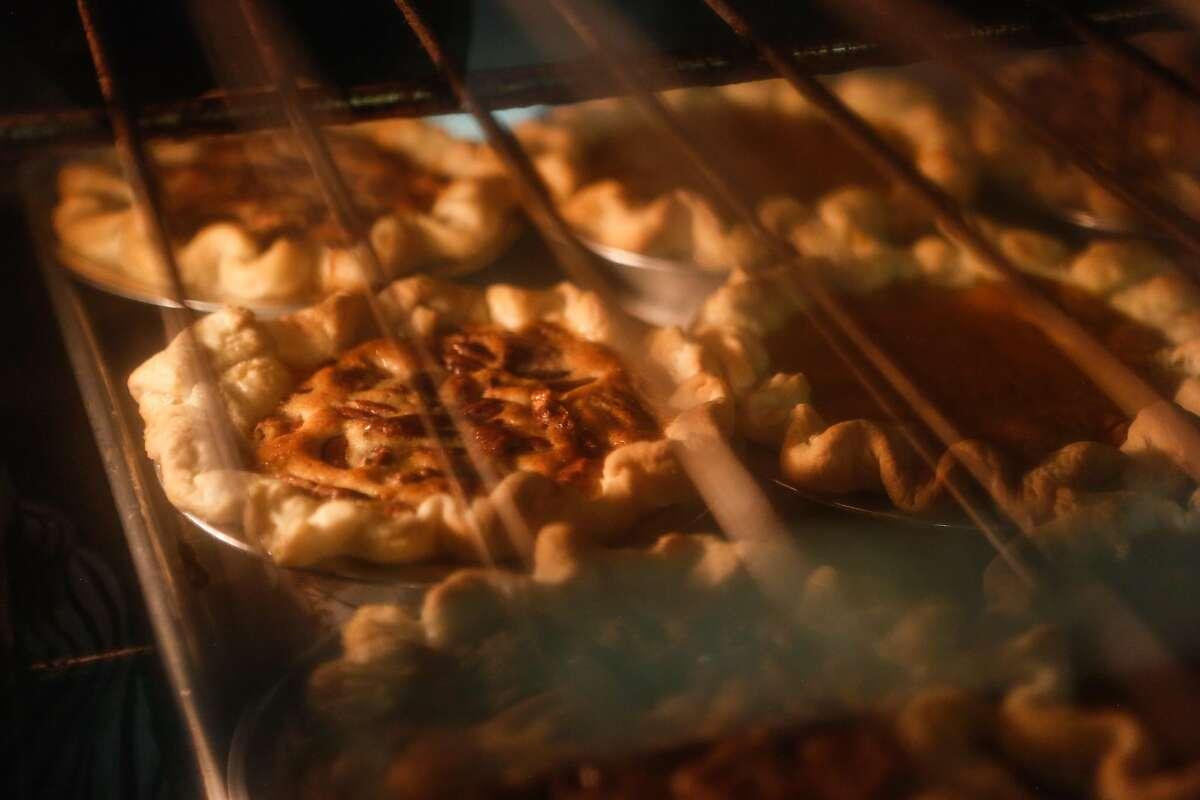 Mini pecan pies bake in the oven Black Jet Baking Co. on Wednesday, November 7, 2018 in San Francisco, Calif.