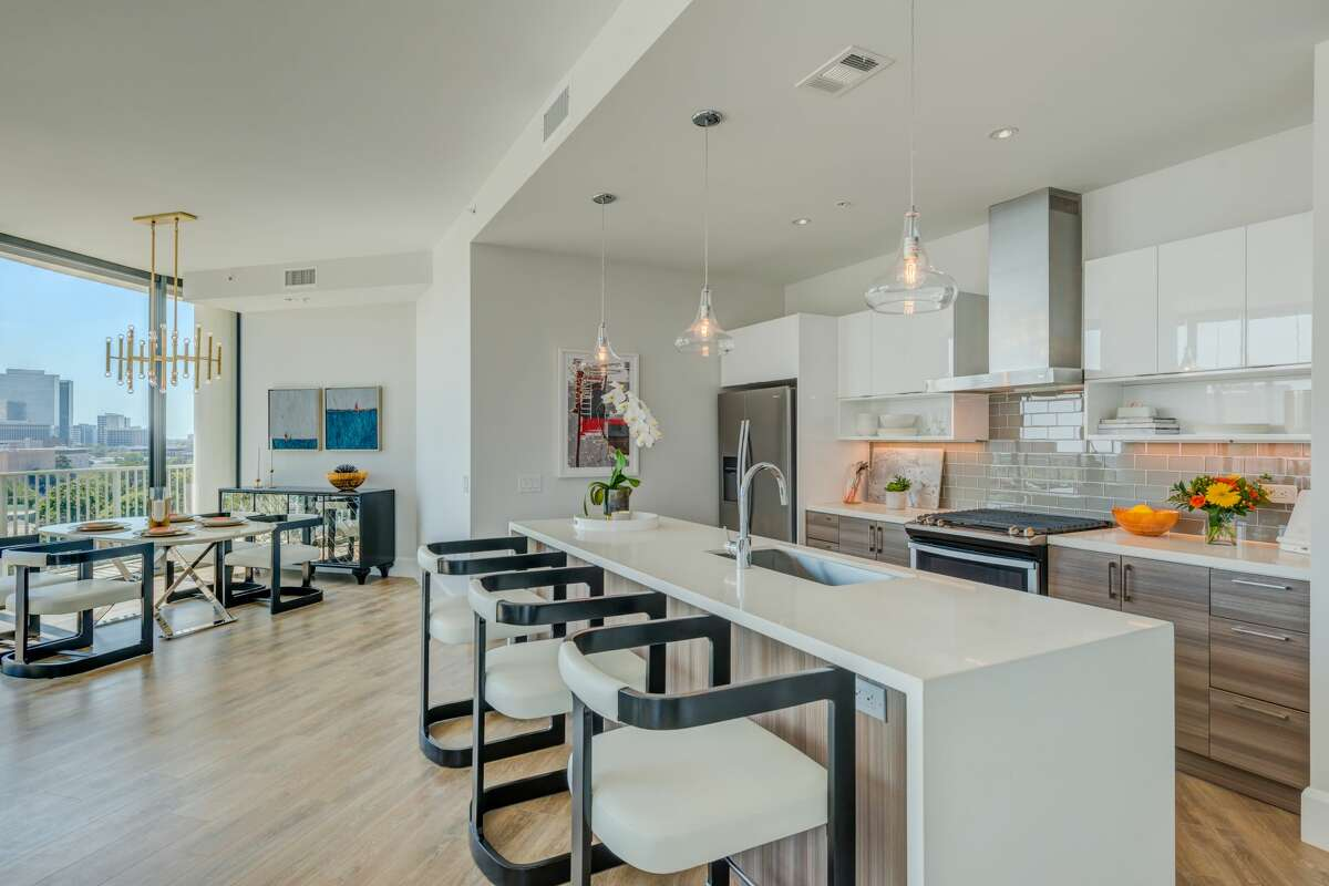 Every unit in the building is decked out with floor-to-ceiling windows anda European-style kitchen featuring a wine fridge and waterfall countertops.